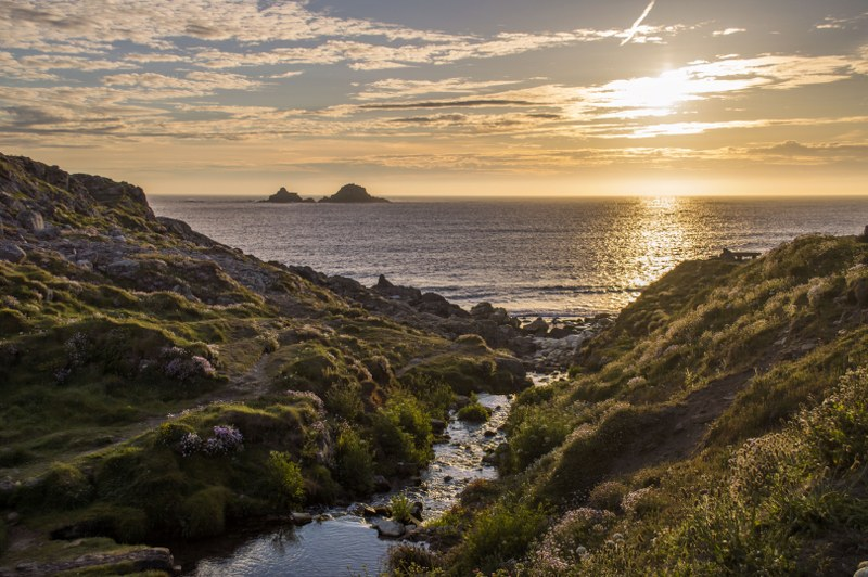 Porth Nanven, a stunning hidden calley and cove near Cape Cornwall, with the Brisons in the background