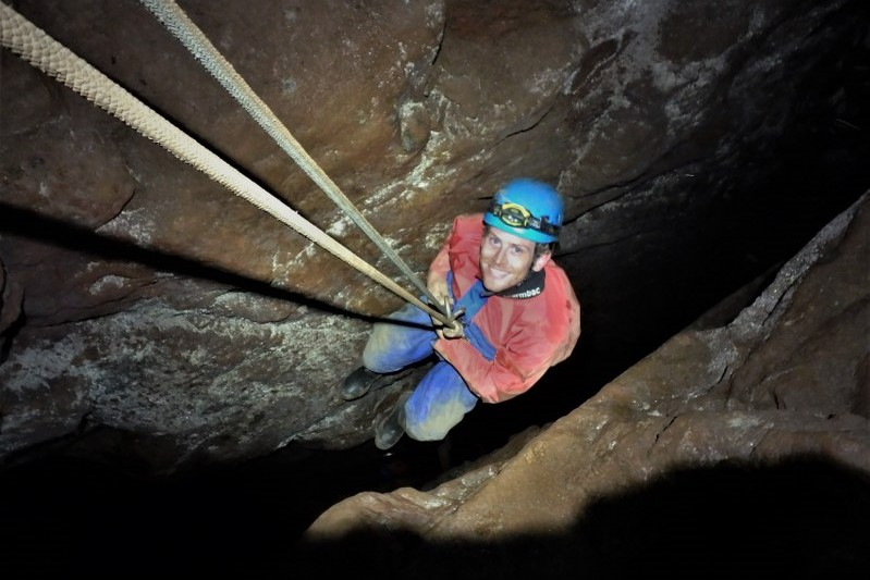 Abseiling down a mine shaft in Wheal Hermon, St. Just Cornwall