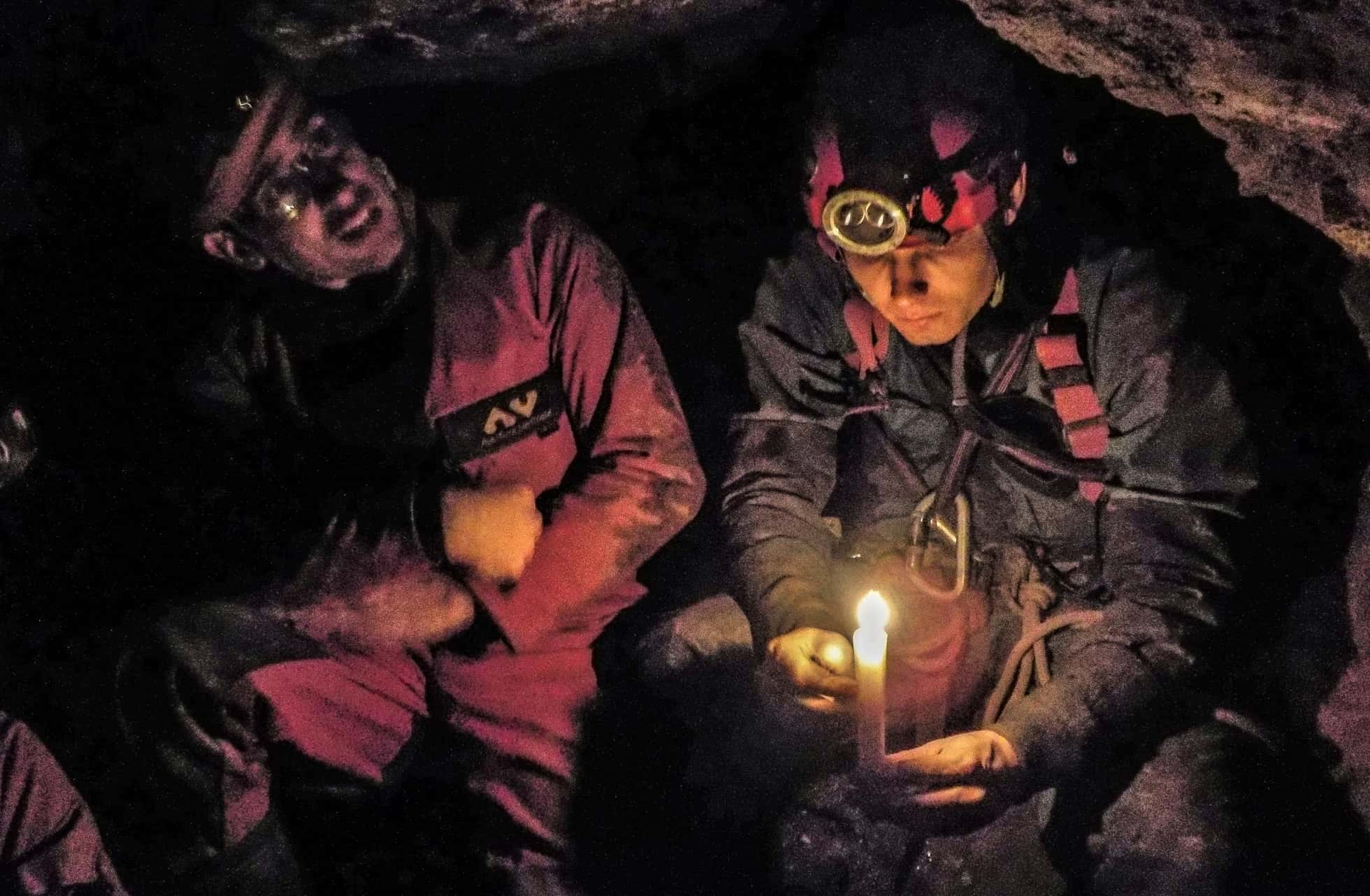 Mine explorers in a Cornish tin mine experiencing candlelight, just like the miners of old.