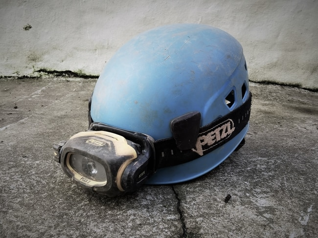 Helmet and head torch combo used for mine exploration in Cornwall