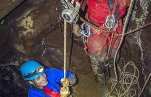 Mine explorers abseiling deep in a Cornish tin mine near St. Just