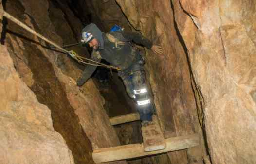 Mine explorer using ropes to cross deep mine shafts. Top adventure in a Cornish tin mine. Mine tours available across Cornwall, near St. Just, St. Ives, Penzance, Newquay, Falmouth and Helston.