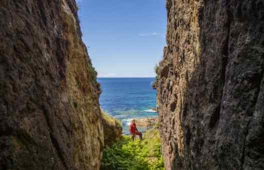 Cornwall Underground Adventure guide exploring an open stope in a Cornish cliff