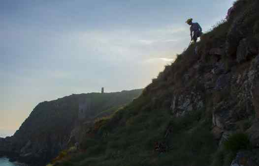 Cornwall Underground Adventures guide on the cliffs, searching for mine history and mining archaeology.