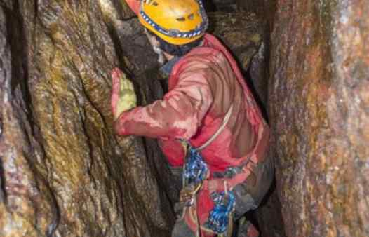 Mine guide drilling and bolting to create an adventurous mine tour. Join Cornwall Underground Adventures for Cornwall's most unique and thrilling day out.