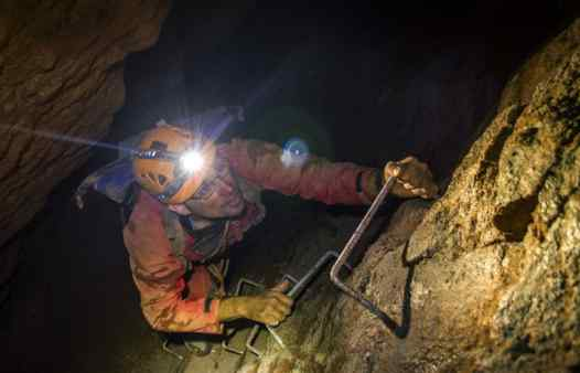Mine tours in Cornwall, go up and down ladders, abseil mine shafts, traverse chasms on an underground mine adventure tour.