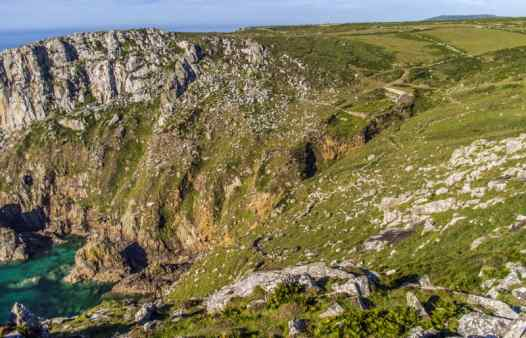 Tin mine ruins in a beautiful Cornish Valley. Cornwall's entire landscape was shaped by tin mining. But the real wonders lie deep underground. Explore underground with Cornwall Underground Adventures.